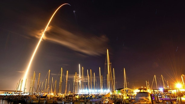 In this image made with an 8-minute long exposure the SpaceX Falcon 9 rocket launches from Cape Canaveral Air Force Station and lands as seen from from the Ocean Club Marina in Port Canaveral, Fla., Sunday, Jan. 7, 2018. On Sunday, SpaceX has launched a secret satellite codenamed Zuma on its first flight of the new year. (Malcolm Denemark/Florida Today via AP)
