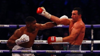 Britain Boxing - Anthony Joshua v Wladimir Klitschko IBF, IBO & WBA Super World Heavyweight Title's - Wembley Stadium, London, England - 29/4/17 Anthony Joshua in action with Wladimir Klitschko Action Images via Reuters / Peter Cziborra Livepic EDITORIAL USE ONLY. - 14786834