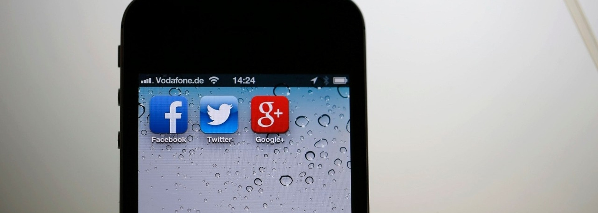 "The application icons of Facebook, Twitter and Google are displayed on an iPhone next to an earphone set in this illustration photo taken in Berlin, June 17, 2013. European firms believe revelations that the U.S. National Security Agency (NSA) PRISM programme secretly gathered user data from nine big U.S. Internet companies, including Microsoft and Google, will hand them a competitive advantage as they play catch-up with the dominant American players in ""cloud computing"".  REUTERS/Pawel Kopczynski (GERMANY - Tags: POLITICS BUSINESS SOCIETY TELECOMS) - BM2E96H14OP01"