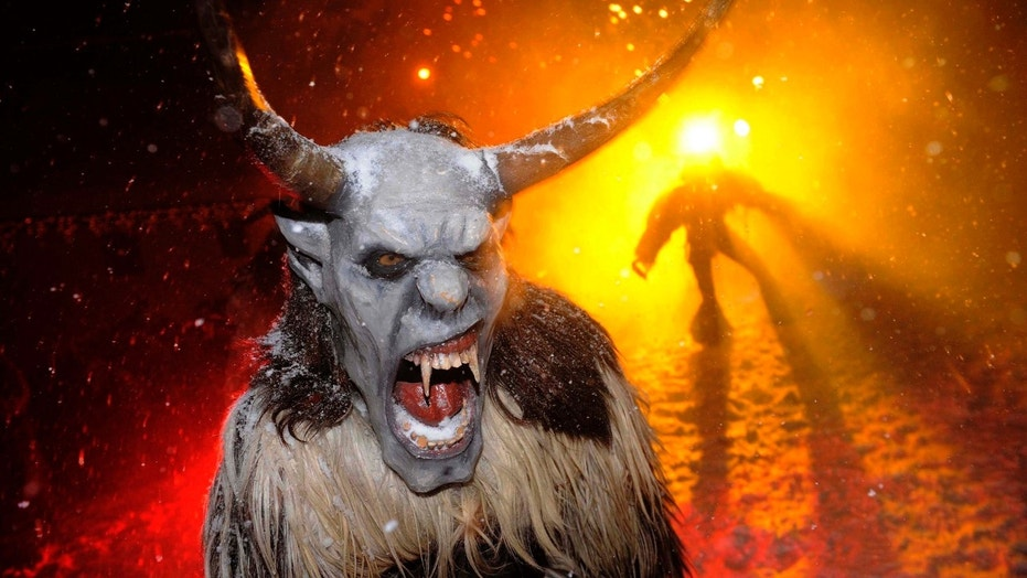 "File photo - Actors dressed as devils perform during the ""gathering of the devils"" ahead of Saint Nicholas Day in Podkoren December 1, 2010. (REUTERS/Bor Slana)"