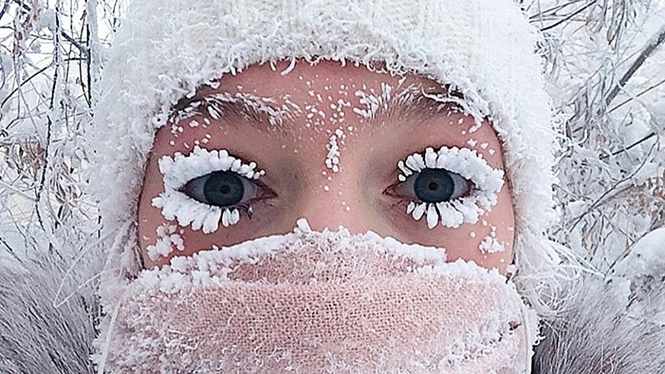 In this photo taken on Saturday, Jan. 13, 2018, Anastasia Gruzdeva poses for selfie as the temperature dropped to about -58 degrees F in Yakutsk, Russia.