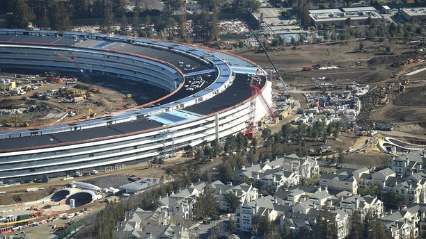 The Apple Campus 2 is seen under construction in Cupertino, California in this aerial photo taken January 13, 2017. REUTERS/Noah Berger - RC18748DED70