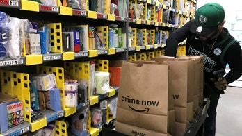 FILE PHOTO: An employee collects items ordered by Amazon.com customers through the company's two-hour delivery service Prime Now in a warehouse in San Francisco, California, U.S., December 20, 2017.   REUTERS/Jeffrey Dastin/File Photo                              GLOBAL BUSINESS WEEK AHEAD        SEARCH GLOBAL BUSINESS 29 JAN FOR ALL IMAGES - RC1EFD9C1520