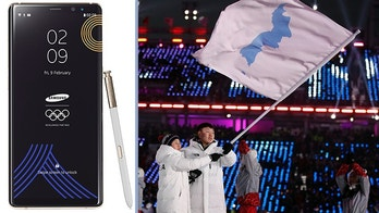 North Korea's Hwang Chung Gum and South Korea's Won Yun-jong carries the flag during the opening ceremony of the 2018 Winter Olympics in Pyeongchang, South Korea, Friday, Feb. 9, 2018. (AP Photo/Jae C. Hong)