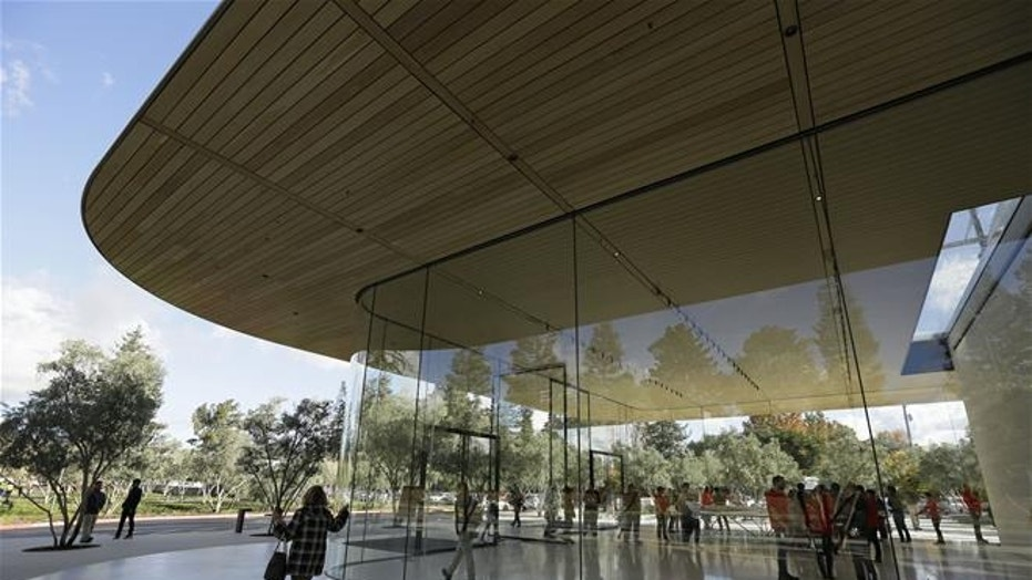 Shown is an exterior view of the Apple Park Visitor Center during its grand opening Friday, Nov. 17, 2017, in Cupertino, Calif.