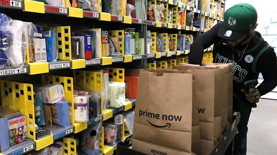 FILE PHOTO: An employee collects items ordered by Amazon.com customers through the company's two-hour delivery service Prime Now in a warehouse in San Francisco, California, U.S., December 20, 2017. (REUTERS/Jeffrey Dastin)