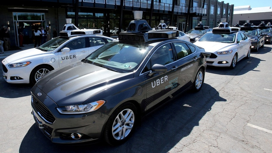 A fleet of Uber's Ford Fusion self-driving cars are shown in Pittsburgh, Pennsylvania.