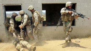 "U.S. Marines carry a ""wounded"" soldier, injured by a simulated improvised explosion, during a simulated training of a search through an Iraqi city built at the U.S. Marine Base in Camp Pendleton, California, June 29, 2006. Approximately 1,000 Marines from the 1st Battalion, 24th Marine Regiment, 4th Marine Division are conducting training at Camp Pendleton in preparation for deployment to Iraq. In this exercise 170 mostly reserve soldiers secured ""Combat Town"" in about one hour.   REUTERS/Mike Blake (UNITED STATES) - GM1DSYDXSNAA"