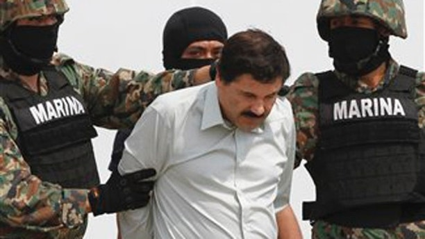 """Joaquin """"El Chapo"""" Guzman is escorted to a helicopter in handcuffs by Mexican navy marines at a navy hanger in Mexico City, Saturday, Feb. 22, 2014. A senior U.S. law enforcement official said Saturday, that Guzman, the head of Mexicoís Sinaloa Cartel, was captured alive overnight in the beach resort town of Mazatlan. Guzman faces multiple federal drug trafficking indictments in the U.S. and is on the Drug Enforcement Administrationís most-wanted list. (AP Photo/Marco Ugarte)"""