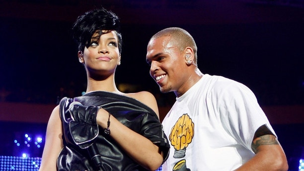 Musicians Chris Brown and Rihanna perform during the Z100 Jingle Ball in New York December 13, 2008. REUTERS/Lucas Jackson (UNITED STATES) - GM1E4CD12WX01