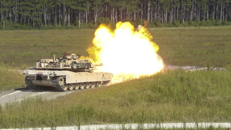 Marines fire an M1A1 Abrams tank during a gunnery range at Camp Lejeune, N.C., Sept. 19, 2017.