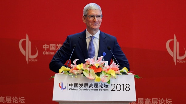 Apple Inc's Chief Executive Officer Tim Cook speaks at the China Development Forum in Beijing, China March 24, 2018. REUTERS/Stringer ATTENTION EDITORS - THIS IMAGE WAS PROVIDED BY A THIRD PARTY. CHINA OUT. - RC1EDDC76DC0