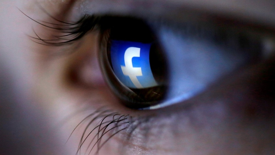 FILE PHOTO: A picture illustration shows a Facebook logo reflected in a person's eye, in Zenica, March 13, 2015. (REUTERS/Dado Ruvic/Illustration)