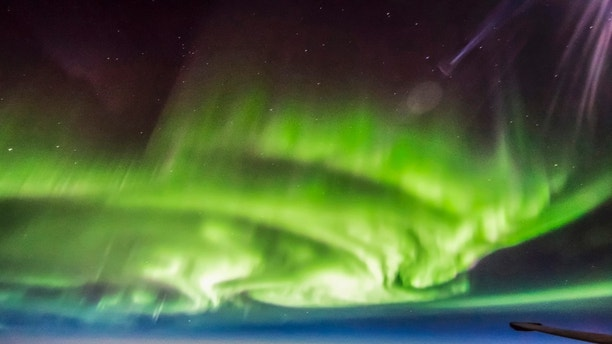 *Mandatory Picture Credit* Extreme Ross Photography / Caters - (Pictured: Ross Franquemont flies through aurora over Canada.) - This fortunate air force pilot couldnt believe his luck, as he captured a series of stunning photographs while flying right through the NORTHERN LIGHTS. Ross Franquemonts once-in-a-lifetime shots include an amazing selfie, where the green natural light can be seen reflecting on the pilots helmet and swirling around outside the cockpit window. In others, 40-year-old Ross managed to photograph straight down the line of his U-2 Dragon Lady planes wings, the aurora dancing across the sky in the distance. What made the moment even more special for Ross was that he had never even seen the Northern Lights before. - SEE CATERS COPY