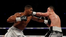 Boxing - Anthony Joshua vs Joseph Parker - World Heavyweight Title Unification Fight - Principality Stadium, Cardiff, Britain - March 31, 2018   Anthony Joshua in action with Joseph Parker   Action Images via Reuters/Andrew Couldridge - RC17295EB910
