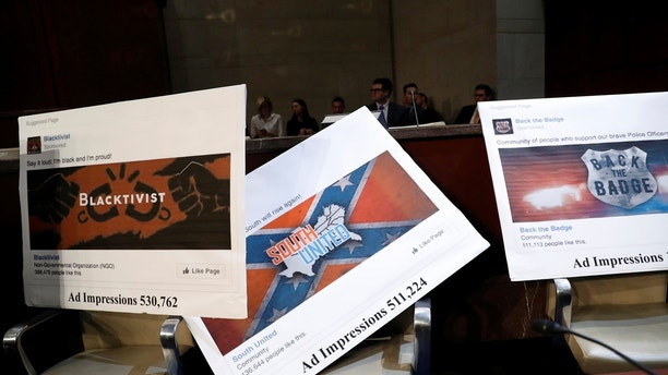 Examples of Facebook pages are seen, as executives appear before the House Intelligence Committee to answer questions related to Russian use of social media to influence U.S. elections, on Capitol Hill in Washington, U.S., November 1, 2017. REUTERS/Aaron P. Bernstein - RC1FD51D5650