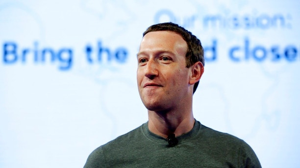 FILE - In this June 21, 2017, file photo, Facebook CEO Mark Zuckerberg speaks during preparation for the Facebook Communities Summit, in Chicago. Zuckerberg embarked on a rare media mini-blitz Wednesday, March 22, 2018, in the wake of a privacy scandal involving a Trump-connected data-mining firm. (AP Photo/Nam Y. Huh, File)