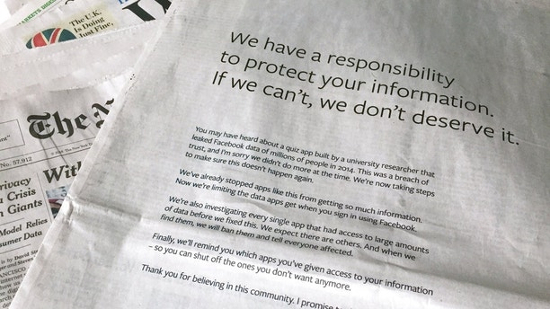 An advertisement in The New York Times is displayed on Sunday, March 25, 2018, in New York. Facebook's CEO apologized for the Cambridge Analytica scandal with ads in multiple U.S. and British newspapers Sunday. The ads signed by Mark Zuckerberg say the social media platform doesn't deserve to hold personal information if it can't protect it. (AP Photo/Jenny Kane)