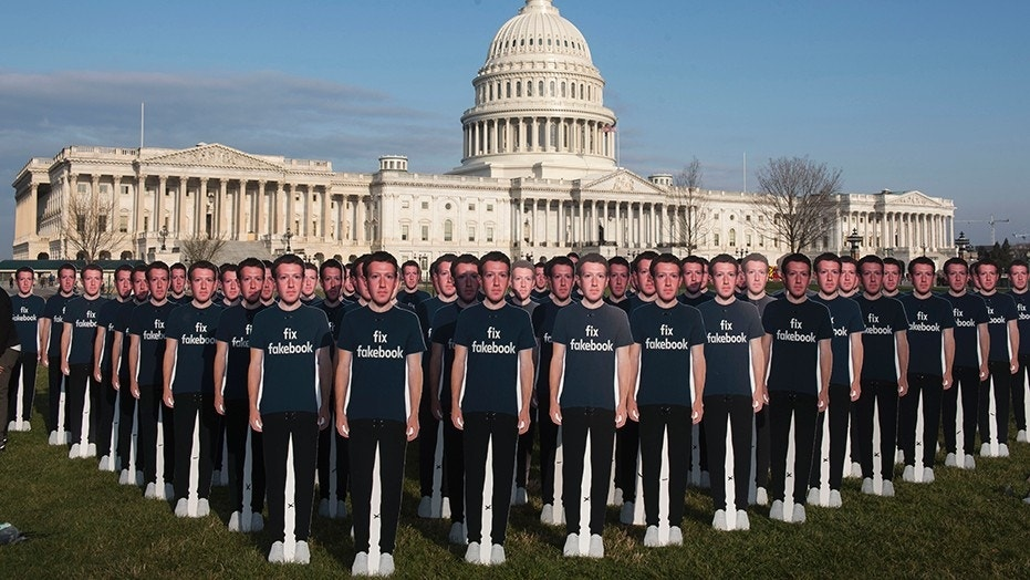 While Mark Zuckerberg prepares to testify before the Senate, 100 cardboard cutouts of the Facebook founder and CEO stand outside the U.S. Capitol in Washington on Tuesday, April 10, 2018.