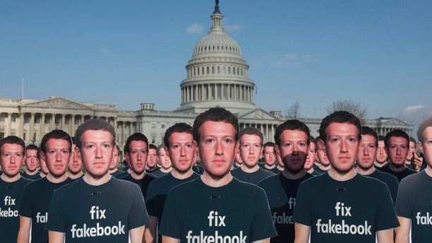 IMAGE DISTRIBUTED FOR AVAAZ - While Mark Zuckerberg prepares to testify before the Senate, 100 cardboard cutouts of the Facebook founder and CEO stand outside the U.S. Capitol in Washington on Tuesday, April 10, 2018. Advocacy group Avaaz is calling attention to hundreds of millions of fake accounts still spreading disinformation on Facebook, and calling for the social media giant to submit to an independent audit. (Kevin Wolf/AP images for AVAAZ)