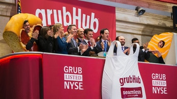 GrubHub CEO Matt Maloney (C) applauds after ringing the opening bell before the company's IPO on the floor of the New York Stock Exchange in New York April 4, 2014. Shares of GrubHub Inc, the biggest U.S. online food-delivery service, rose as much as 57 percent in its market debut as investors scrambled for a piece of the fast-growing consumer internet company. REUTERS/Lucas Jackson (UNITED STATES - Tags: BUSINESS FOOD) - GM1EA441T0D01