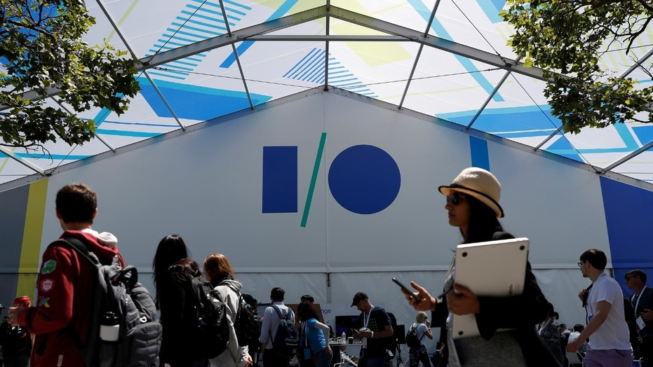 File photo: Attendees walk past a building during the annual Google I/O developers conference in San Jose, California, U.S., May 17, 2017. (REUTERS/Stephen Lam)