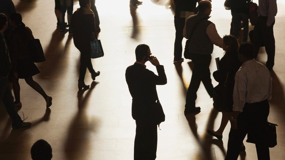 File photo - A man stands in the middle of Grand Central Terminal as he speaks on a cell phone, as passengers face limited train service on the New Haven Line between Stamford Station and Grand Central Terminal due to a Con Edison power problem in New York, Sept. 25, 2013. (REUTERS/Zoran Milich)