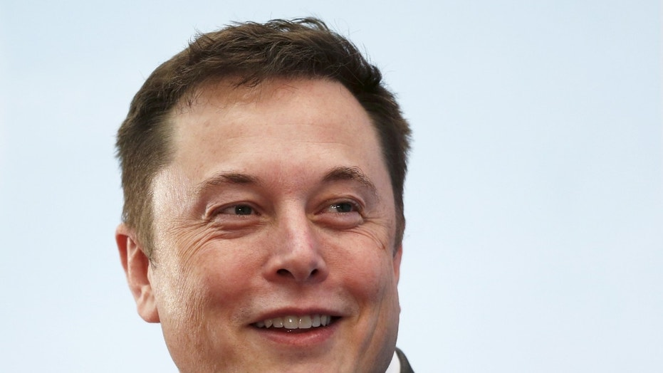 File photo: Tesla Chief Executive Elon Musk smiles as he attends a forum on startups in Hong Kong, China January 26, 2016. REUTERS/Bobby Yip)