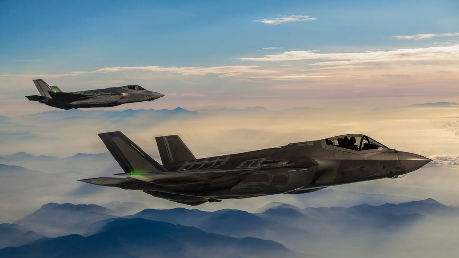 Fighter Jets flying over the fogy mountains at dusk (Credit: iStock)