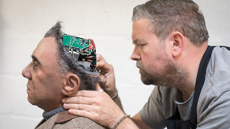 PENRYN, ENGLAND - MAY 09: Engineered Arts prosthetic expert Mike Humphrey checks on Fred a recently completed Mesmer robot that was built at the company's headquarters in Penryn on May 9, 2018 in Cornwall, England. (Photo by Matt Cardy/Getty Images)