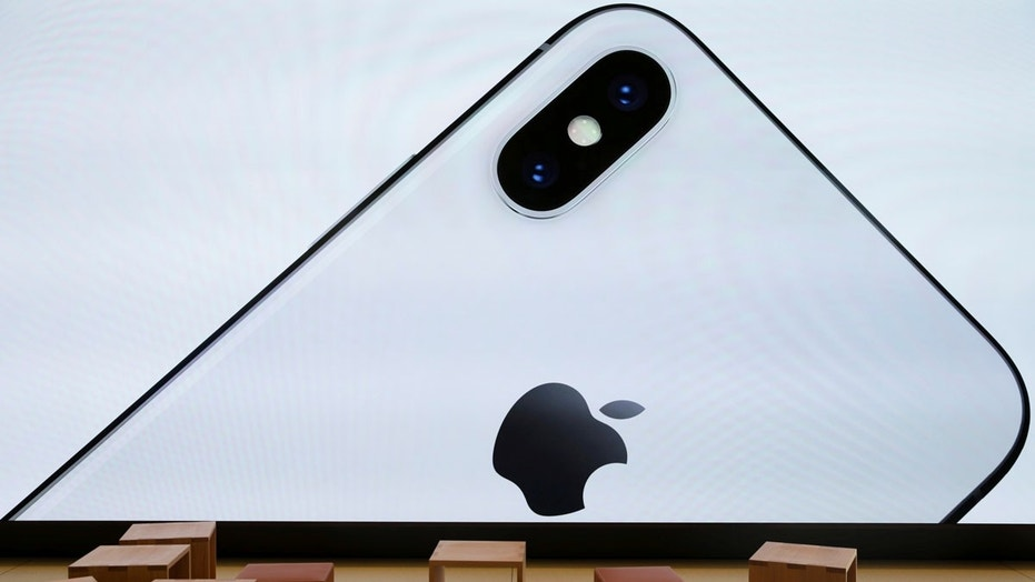 File photo: An iPhone X is seen on a large video screen in the new Apple Visitor Center in Cupertino, California, U.S., November 17, 2017. (REUTERS/Elijah Nouvelage)