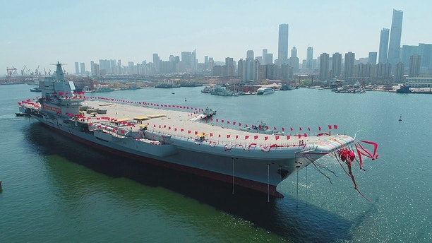 FILE - In this April 26, 2017, file photo released by China's Xinhua News Agency, China's newly-built aircraft carrier Liaoning is transferred from dry dock into the water at a launch ceremony at a shipyard in Dalian. China's first entirely home-built aircraft carrier has begun sea trials in a sign of the growing sophistication of the country's domestic arms industry.  State media said the still-unnamed ship left dock in the northern port of Dalian early Sunday, May 13, 2018,  and the Liaoning provincial maritime safety bureau issued an order for shipping to avoid a section of ocean southeast of the city between Sunday and Friday. (Li Gang/Xinhua via AP, File)