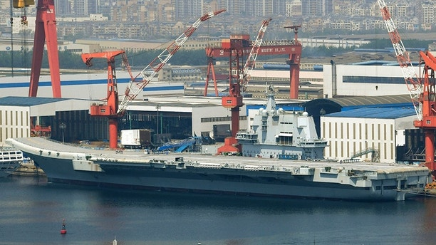 This May 9, 2018, photo released by China's Xinhua News Agency shows China's aircraft carrier Liaoning at a shipyard in Dalian. China's first entirely home-built aircraft carrier has begun sea trials in a sign of the growing sophistication of the country's domestic arms industry. State media said the still-unnamed ship left dock in the northern port of Dalian early Sunday, May 13, 2018, and the Liaoning provincial maritime safety bureau issued an order for shipping to avoid a section of ocean southeast of the city between Sunday and Friday. (Minoru Iwasaki/Kyodo News via AP)