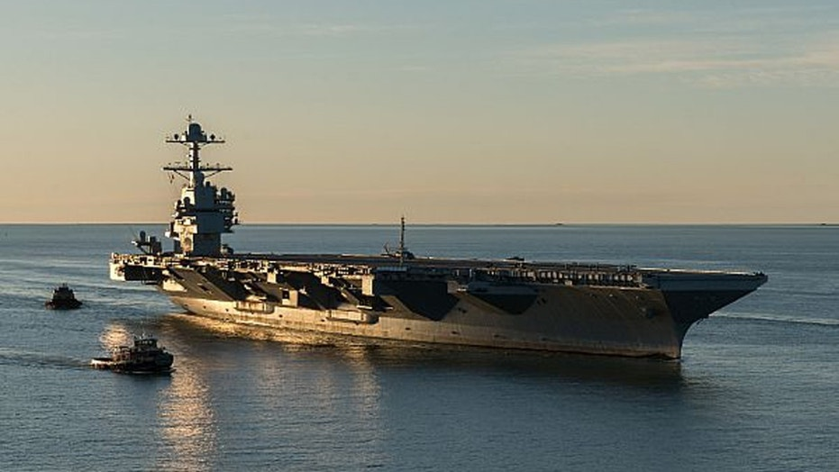 File photo: (April 14, 2017) The aircraft carrier Pre-Commissioning Unit (PCU) Gerald R. Ford (CVN 78) pulls into Naval Station Norfolk for the first time. (U.S. Navy photo by Matt Hildreth courtesy of Huntington Ingalls Industries/Released) (©Newport News Shipbuilding 2017)