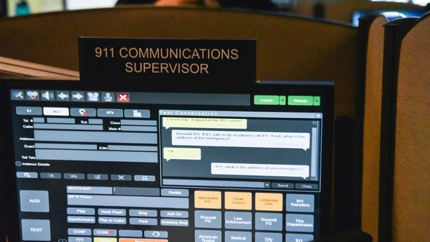 This photo taken March 15, 2018 shows a 911 call center in Roswell, Ga., with one of the computer screens used by dispatchers shows a text message that has come into the system. The Roswell call center is one of the few in the United States that accepts text messages. This year is the 50th anniversary of the first 911 call placed in the United States and authorities say it is in desperate need to have its technology modernized.   (AP Photo/Lisa Marie Pane)