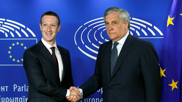 Facebook's CEO Mark Zuckerberg shakes hands with European Parliament President Antonio Tajani at the European Parliament in Brussels, Belgium May 22, 2018. REUTERS/Yves Herman - RC1A84A40F50