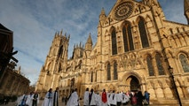 Members of the clergy enter York Minster before a service to consecrate Reverend Libby Lane as the first female bishop in the Church of England, in York, northern England January 26, 2015. REUTERS/Phil Noble (BRITAIN - Tags: RELIGION) - GM1EB1Q1HRE01
