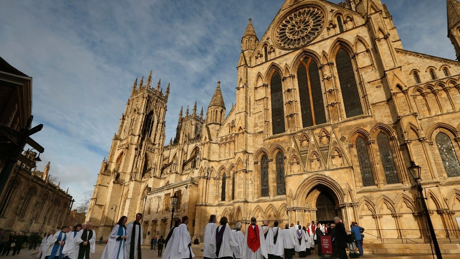 File photo - Members of the clergy enter York Minster before a service to consecrate Reverend Libby Lane as the first female bishop in the Church of England, in York, northern England January 26, 2015. (REUTERS/Phil Noble)
