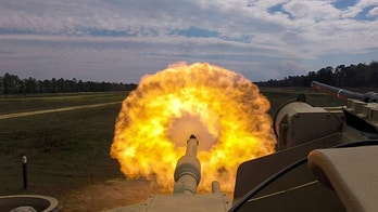 Troopers with the U.S. Army 2nd Armored Brigade Combat Team, 3rd Infantry Division fire the main gun round at a target during unit gunnery practice with newly acquired M1A1-SA Abrams tanks at Fort Stewart, Georgia, U.S. March 29, 2018. Picture taken March 29, 2018. U.S. Army/Handout via REUTERS.    ATTENTION EDITORS - THIS IMAGE WAS PROVIDED BY A THIRD PARTY - RC17E55928B0