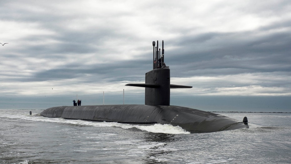 File photo - The Ohio-class ballistic missile submarine USS Tennessee returns to Naval Submarine Base Kings Bay, Georgia in this Feb. 6, 2013 handout photo. (REUTERS/Mass Communication Specialist 1st Class James Kimber/U.S. Navy/Handout via Reuters)