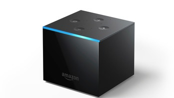 This undated image provided by Amazon.com, Inc. shows an Amazon Fire TV Cube. Amazon unveiled the new voice-controlled Fire TV device, which lets users shout out when they want to turn on the TV, flip channels or search for sitcoms, all without pushing any buttons. The Fire TV Cube is not entirely hands-free yet, however. Some apps or streaming services may require viewers to pick up the included remote to rewind or stop a show. (Amazon.com, Inc. via AP)