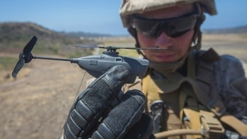 MARINE CORPS BASE CAMP PENDLETON, Calif. - U.S.  Marine Lance Cpl. Cesar Salinas, an infantry Marine with Kilo Company, 3rd Battalion 5th Marine Regiment, displays the PD-100 Black Hornet after an exercise for Marine Corps Warfighting Laboratory's Marine Air-Ground Task Force Integrated Experiment on Camp Pendleton, Calif., July 9, 2016. The Warfighting Lab is conducting an experiment in conjunction with the Rim of the Pacific exercise to explore new gear and assess its capabilities for potential future use. The Warfighting Lab identifies possible challenges of the future, develops new warfighting concepts, and tests new ideas to help develop equipment that meets the challenges of the future operating environment. (U.S. Marine Corps photo by Pfc. Rhita Daniel/Released)