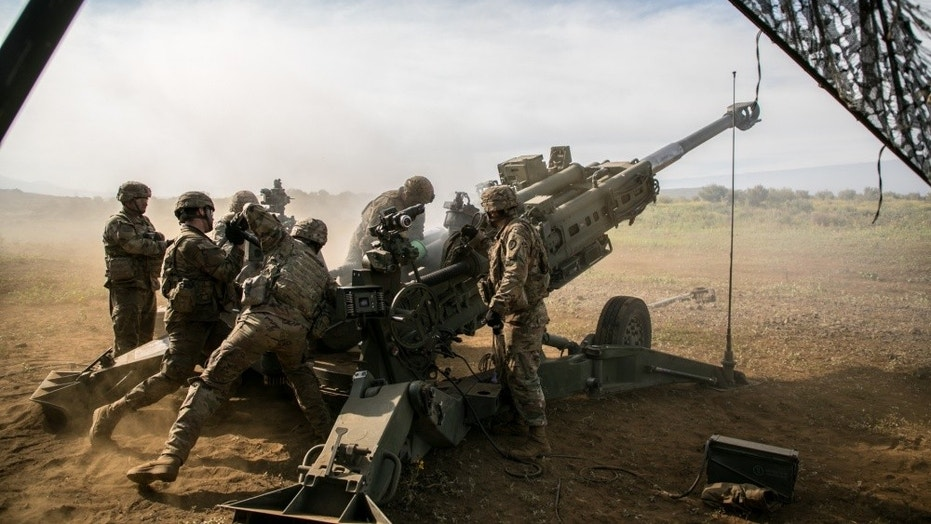 File photo - U.S. Army Soldiers assigned to 25th Division Artillery, 25th Infantry Division, prepare to fire a 155 mm artillery round from an M777 howitzer in support of Operation Lightning Strike on Pohakuloa Training Area, Hawaii, May 16, 2018. Operation Lightning Strike is a combined arms live-fire exercise that increases unit interoperability and synchronization in an effort to concentrate combat power on the battlefield. (U.S. Army photo by Sgt. Ian Morales)