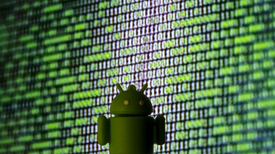 A 3D printed Android logo is seen in front of a displayed cyber code in this illustration taken March 22, 2016. REUTERS/Dado Ruvic/Illustration - RTSBS6B