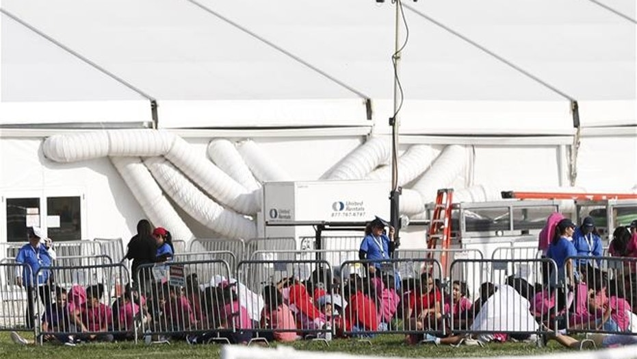Immigrant children are shown outside a former Job Corps site that now houses them, Monday, June 18, 2018, in Homestead, Fla. It is not known if the children crossed the border as unaccompanied minors or were separated from family members.