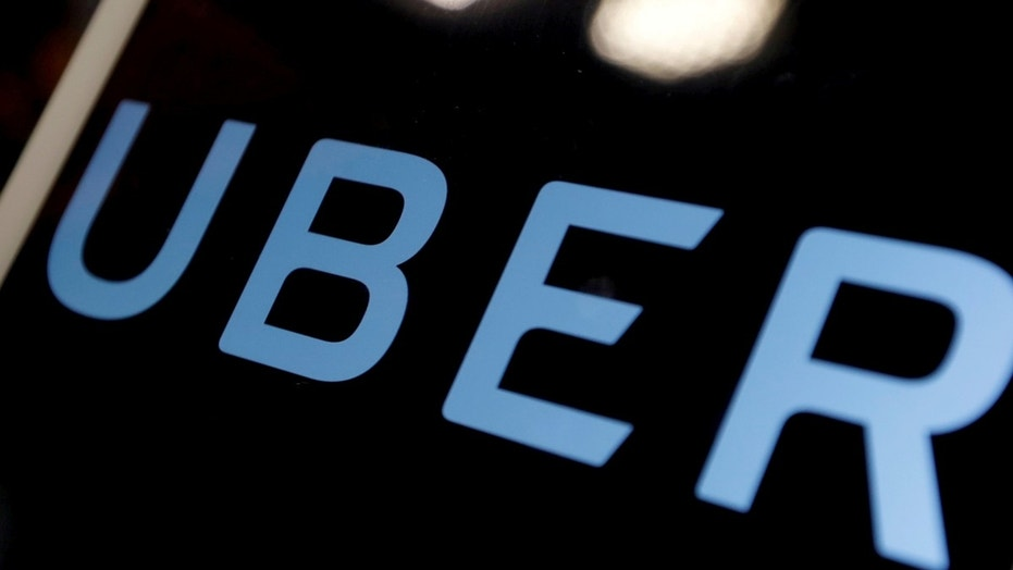 FILE PHOTO: The logo of Uber is seen on an iPad, during a news conference to announce Uber resumes ride-hailing service, in Taipei, Taiwan April 13, 2017. REUTERS/Tyrone Siu/File Photo - RC177BFACD80