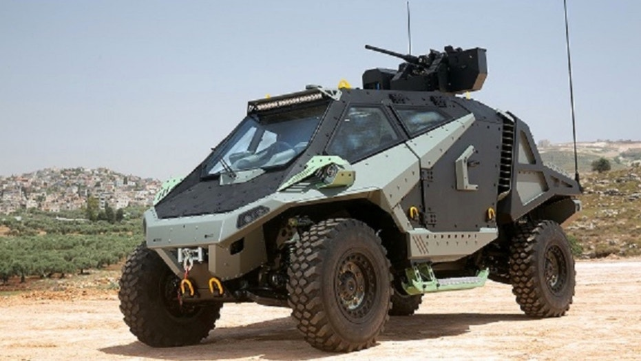 1529679173006 - New futuristic Israeli'dune-buggy' is bristling with weapons, ready for combat