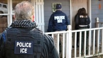 FILE  - In this Feb. 9, 2017, file photo provided by U.S. Immigration and Customs Enforcement, ICE agents stand outside a home in Atlanta during a targeted enforcement operation aimed at immigration fugitives, re-entrants and at-large criminals living in the country illegally. With seven Georgia Republicans jockeying for their party's nomination, illegal immigration is one thing that the leading candidates are largely in agreement on: the state may have some of the toughest laws targeting illegal immigration in the country, but it needs to do more, they say. (Bryan Cox/ICE via AP, File)