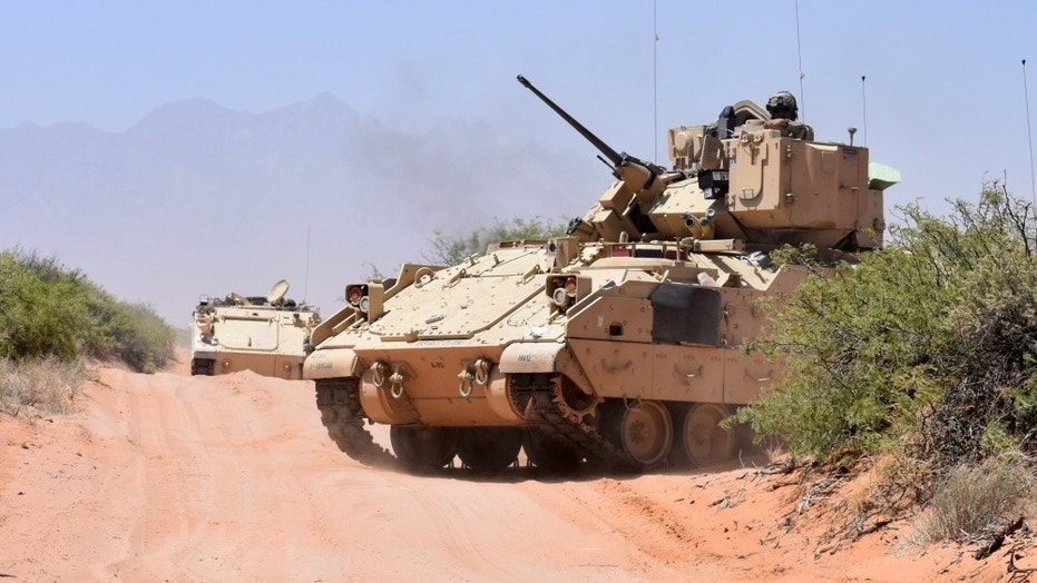 File photo - Soldiers assigned to Company B, 2nd Battalion, 198th Infantry Regiment, 155th Armored Brigade Combat Team, Mississippi Army National Guard, ride in a Bradley Fighting Vehicle after an exercise near the El Jarbah training village on Doña Ana Range, N.M., April 20, 2018. (Winifred Brown, Fort Bliss Public Affairs Office)