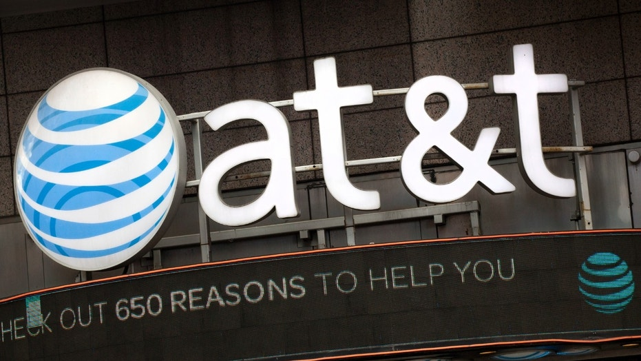 FILE - In this Oct. 24, 2016, file photo, the AT&T logo is positioned above one of its retail stores in New York.  (AP Photo/Mark Lennihan, File) (Copyright 2016 The Associated Press. All rights reserved.)